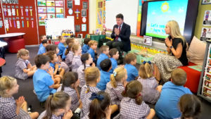 Sydney Catholic Schools' Executive Director, Anthony Farley, and teacher Fiona Mace with Kindy students
